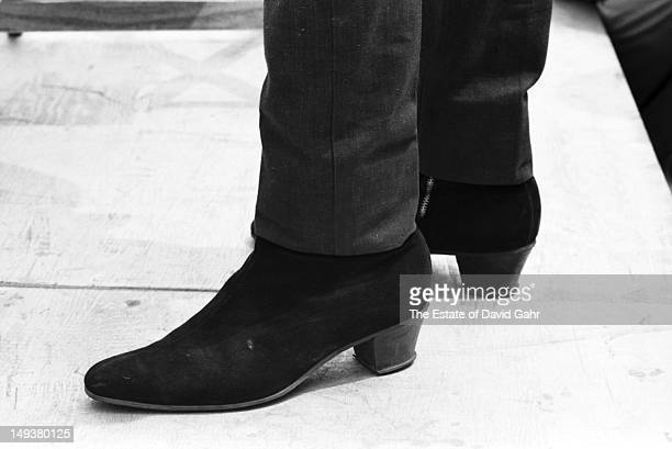 Detail of singer songwriter Bob Dylan's boots as he performs onstage on the Newport Folk Festival in July 1965 in Newport Rhode Island