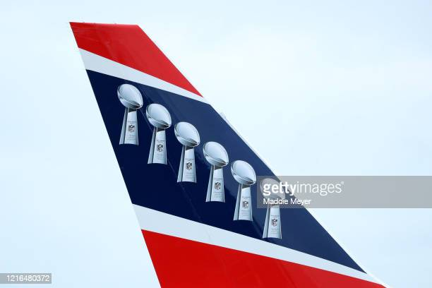 A detail of six Lombardi Trophies on the tail of the New England Patriots plane after it landed at Logan International Airport on April 2 2020 in...