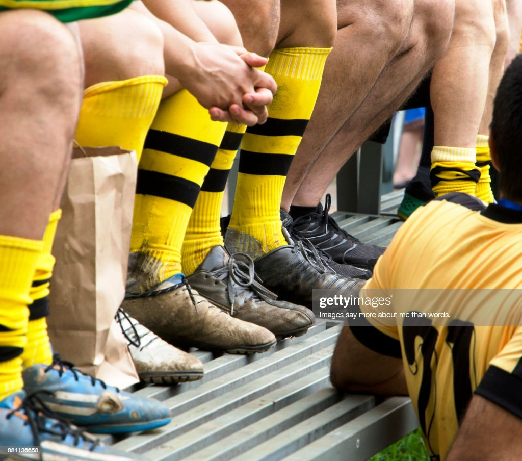 Detail of soccer players legs after a difficult match. : Stock Photo