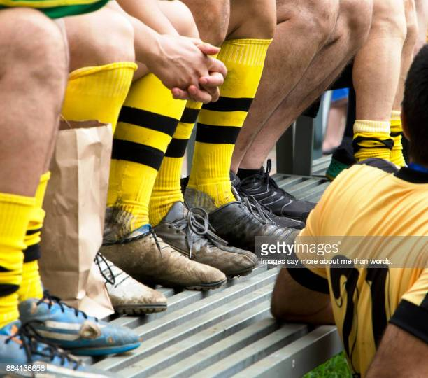 detail of soccer players legs after a difficult match. - clubvoetbal stockfoto's en -beelden