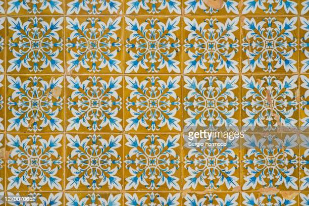 detail of some tiles with geometric shapes and vibrant colours on an old facade in braga, portugal. - cultura portoghese foto e immagini stock