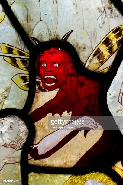 Detail of stained glass window showing the devil crypt of the Church of St Mary Magdalene Rowington Close Paddington London c2012 Artist James O...