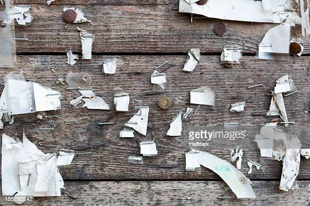 detail of staples, thumbtacks and ripped paper on a wooden wall - bulletin board flyer stock pictures, royalty-free photos & images