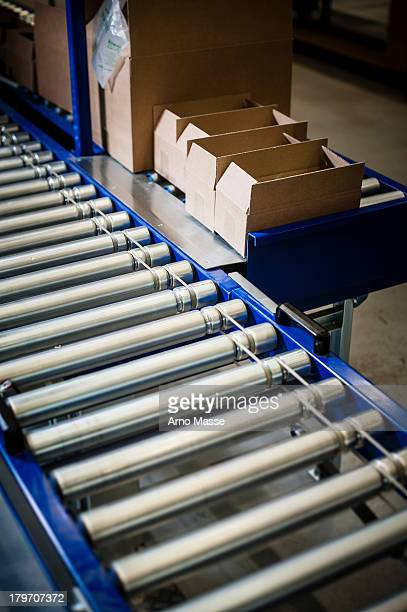 detail of stationary conveyer belt in distribution warehouse - silver belt stock pictures, royalty-free photos & images