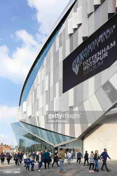 Detail of steel clad facade and fans arriving. The New Tottenham Hotspur Stadium, London, United Kingdom. Architect: Populous, 2019.