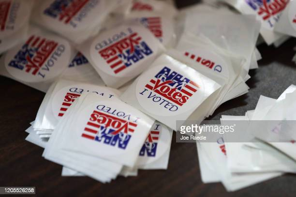 Detail of stickers reading 'NH Votes I Voted' are seen in a polling station setup at the Town Hall on February 11 2020 in Chichester New Hampshire...