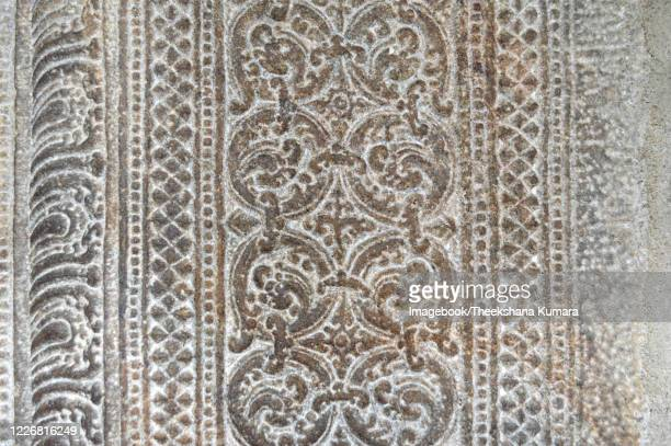 detail of stone decorative arts in temple of the tooth. - imagebook stock pictures, royalty-free photos & images