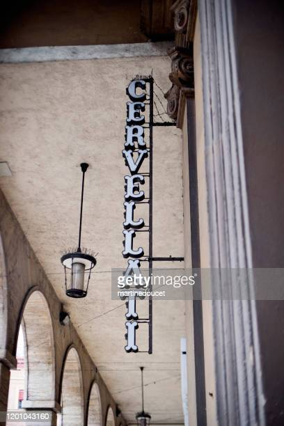 "detail of store sign in the city of bologna, italy. - ""martine doucet"" or martinedoucet stock pictures, royalty-free photos & images"
