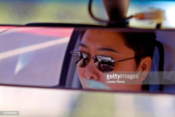 Detail of Taxi Driver in mirror.