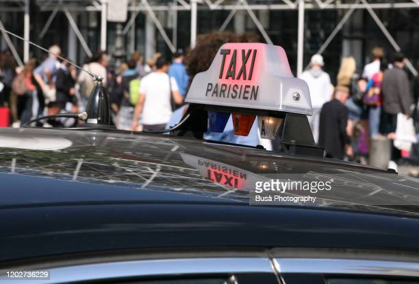 detail of taxi plate on cab in paris, france - centre pompidou stock pictures, royalty-free photos & images