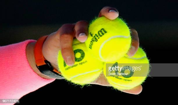 A detail of tennis balls as Rafael Nadal of Spain prepares to serve in his third round match against Damir Dzumhur of Bosnia and Herzogovina on day...