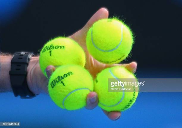 A detail of tennis balls as Stanislas Wawrinka of Switzerland chooses which ball to serve with in his quarterfinal match against Kei Nishikori of...