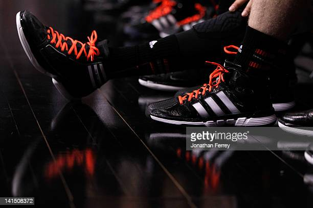 Detail of the Adidas shoes worn by the Louisville Cardinals in the first half against the New Mexico Lobos during the third round of the 2012 NCAA...