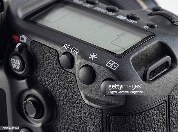 Detail of the AF button on a Canon 5DS R digital SLR taken on June 24 2015