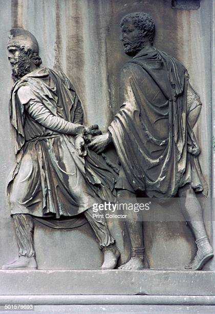 Detail of the Arch of Constantine showing a Roman with a barbarian prisoner 4th century
