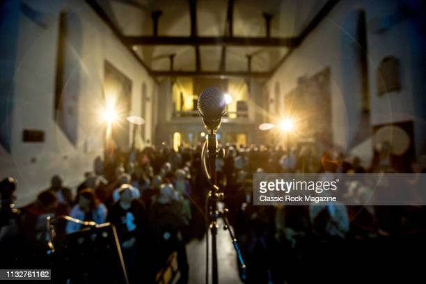 Detail of the audience and microphone photographed before a performance by American rock musician Dan Reed at St Pancras Old Church in London on...