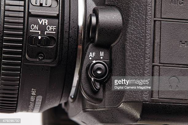 Detail of the Auto Focus and Manual switch on a Nikon D7100 digital SLR camera taken on June 10 2014
