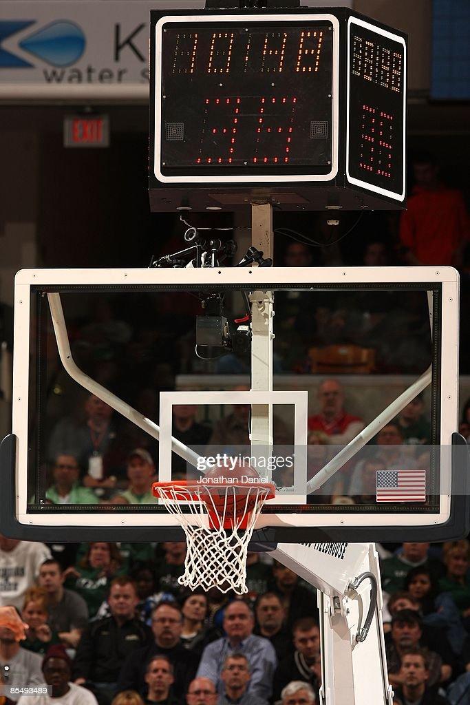 A Detail Of The Backboard And Shot Clock As Basketball Goes Thru Hoop