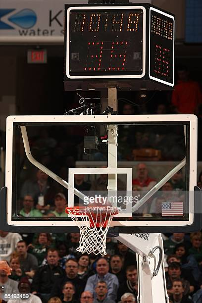 A detail of the backboard and shot clock as a basketball goes thru the hoop as the Michigan State Spartans play against the Ohio State Buckeyes...