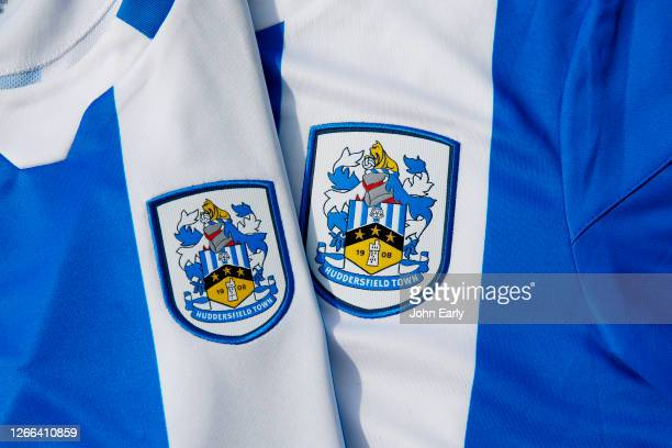 Detail of the badges on the new Huddersfield Town and Huddersfield Town Women's home shirts on August 13, 2020 in Huddersfield, England.