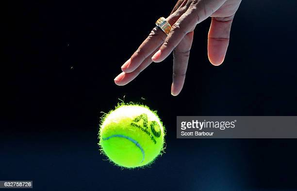 A detail of the ball and the hand of Venus Williams of the United States as she prepares to serve in her semifinal match against CoCo Vandeweghe of...