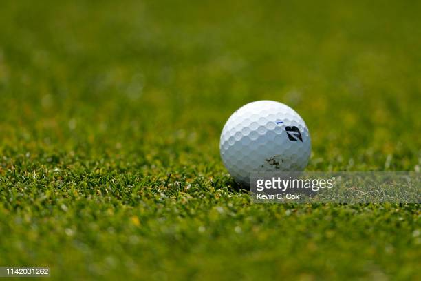 Detail of the ball of Fred Couples of the United States on the 18th green during the first round of the Masters at Augusta National Golf Club on...