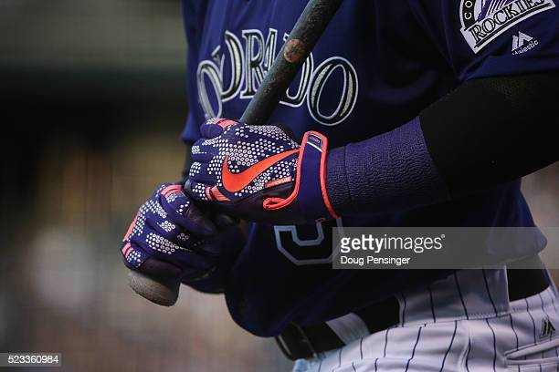 Detail of the batting gloves of Carlos Gonzalez of the Colorado Rockies as he prepares to take an at bat against the Los Angeles Dodgers at Coors...