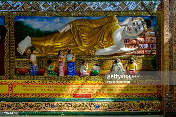 Detail of the big reclining Buddha statue Shwethalyaung Buddha sheltered by a big building one of many important religious places in town
