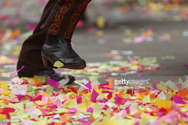 Detail of the boots of a man dressed in charro while participating in the parade commemorating the 20th anniversary of the International Mariachi and...