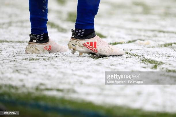 Detail of the boots of Everton's Theo Walcott in the snow during the Premier League match at the bet365 Stadium Stoke