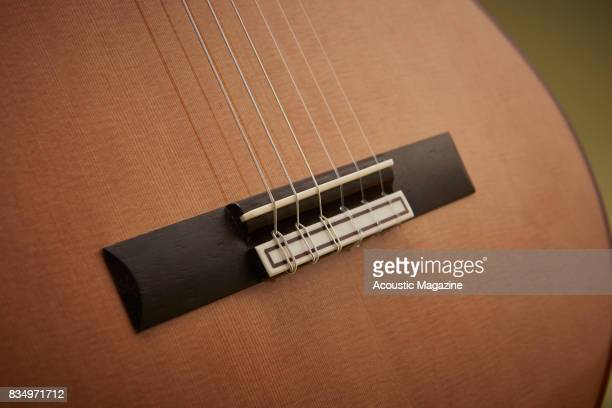 Detail of the bridge on an Admira A25 classical guitar taken on December 14 2016