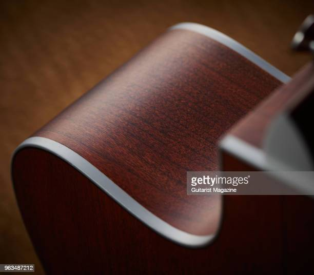 Detail of the cherry wood sides and silver acrylic binding on a Martin OMC16E electroacoustic guitar taken on April 25 2017