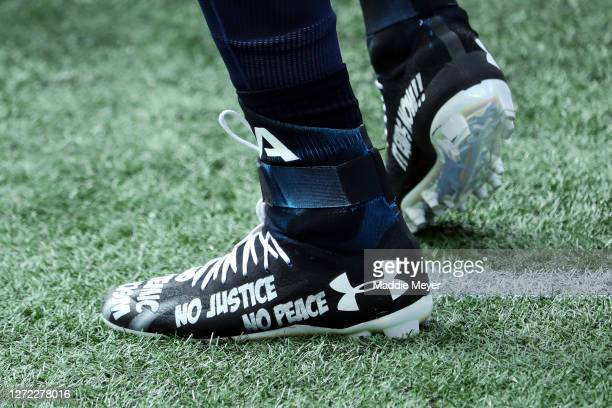 A detail of the cleats of Cam Newton of the New England Patriots before the game between the Miami Dolphins and the New England Patriots at Gillette...