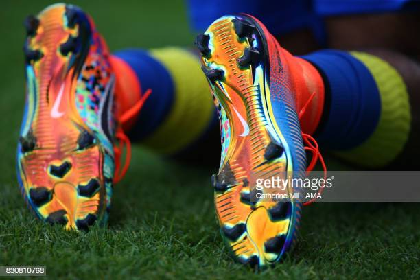 Detail of the coloured bottom and studs of Nike Mercurial X EA Sports boots during the Sky Bet League One match between AFC Wimbledon and Shrewsbury...