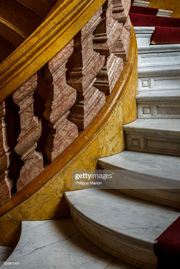 Detail of the colourful Italian Carrara marble staircase at