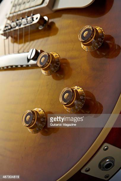 Detail of the control knobs on a 2013 Gibson Custom 1959 Les Paul Standard Reissue electric guitar taken on August 5 2013