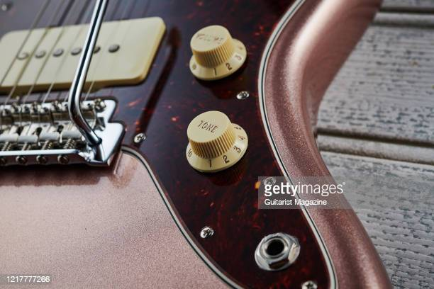 Detail of the control knobs on a Fender American Performer Jazzmaster with a Penny finish taken on July 12 2019