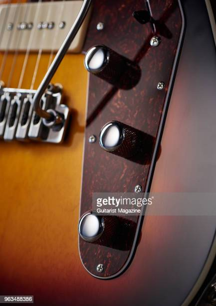 Detail of the control knobs on a Reverend Jetstream 390 electric guitar with a 3-Tone Burst finish, taken on April 5, 2017.