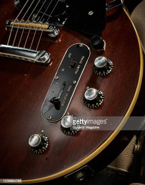 Detail of the control knobs on a vintage 1969 Gibson Les Paul Professional electric guitar with a transparent Walnut finish, taken on July 22, 2019.