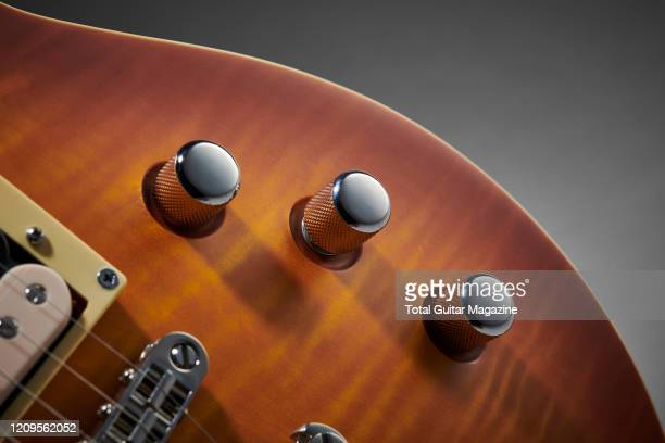 Detail of the control knobs on an LTD EC1000T electric guitar with a Honey Burst Satin finish taken on September 17 2019
