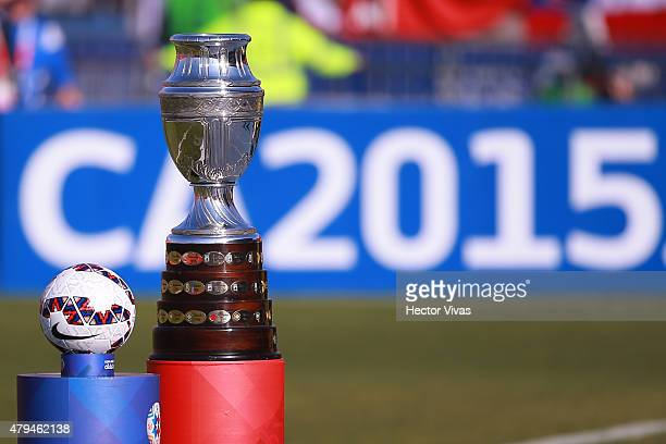 Detail of the Copa America trophy on the plinth next to the official matchball Cachaña prior the 2015 Copa America Chile Final match between Chile...