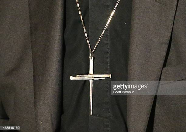 A detail of the cross necklace worn by The Archbishop of Canterbury Justin Welby as he speaks during a press conference ahead of Archbishop Philip...