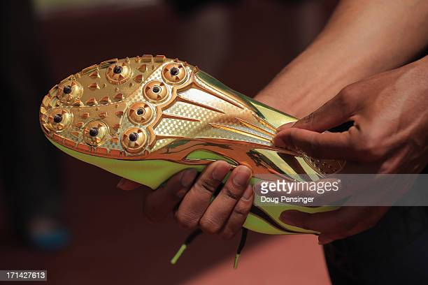A detail of the current shoes of Aries Merritt of the USA Track and Field Team showing that he runs with six cleats in the eight cleak pattern as he...
