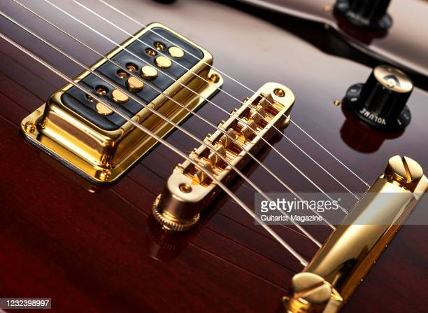 Detail of the DeArmond Dynasonic single coil pickups on a Guild Starfire II ST Dynasonic electric guitar with a Royal Brown finish, taken on February...