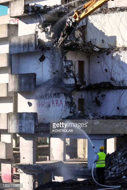 A detail of the demolition of the Green Sail building Vela Verde in Scampia in the suburb of Naples with two crawler excavators The northern...