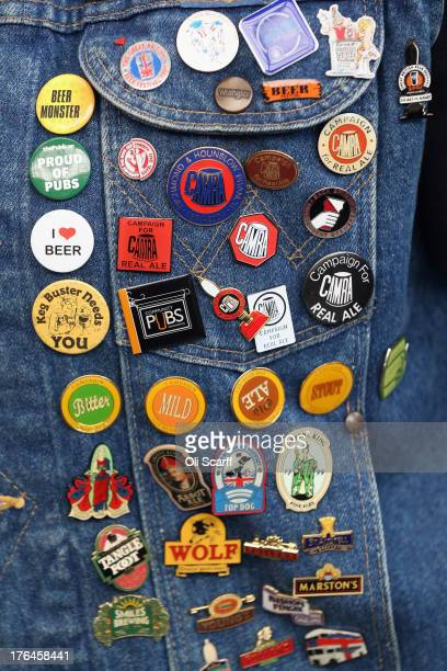 Detail of the denim jacket worn by Lynne Morgan decorated with beerrelated pin badges at the Great British Beer Festival in the Olympia exhibition...