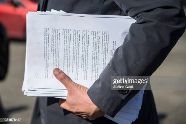 Detail of the documents of a lawyer for the trial outside of the Lorusso and Cutugno Prison for the preliminary hearing of the trial for the facts of...