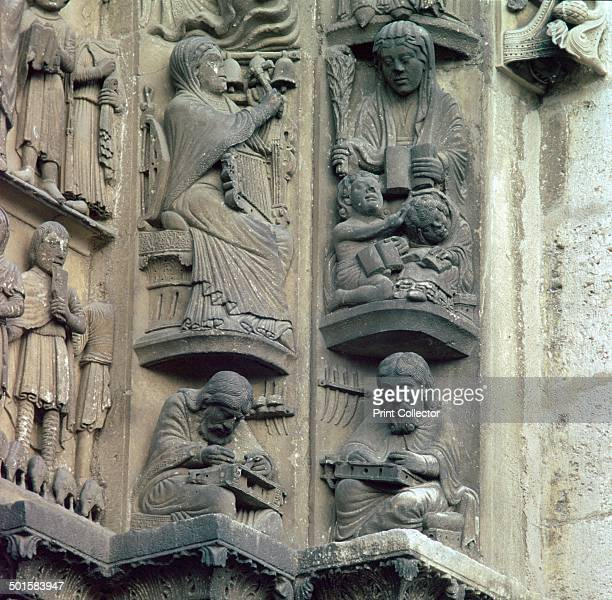 Detail of the doorway on the west front of Chartres Cathedral Pythagoras on the lower left represents music and Donatus on the right represents...