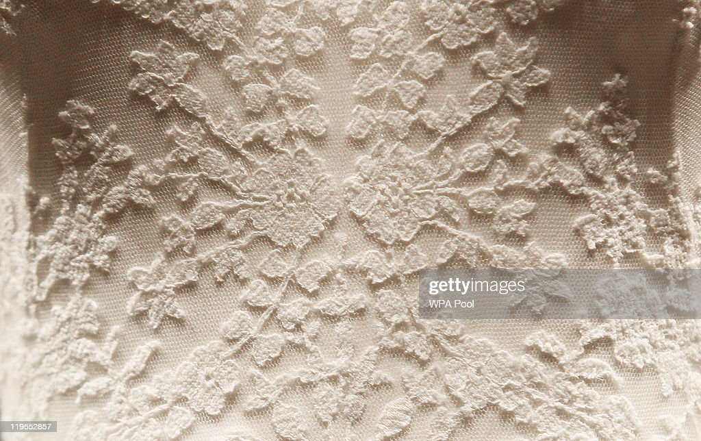 A detail of the Duchess of Cambridge's wedding dress, designed by Sarah Burton for Alexander McQueen, is photographed before it goes on display at Buckingham Palace during the annual summer opening on July 20, 2011 in London, England. The Duchess of Cambridge's dress featured lace appliqué floral detail and was made of ivory and white satin gazar with a 9ft train. It was worn her wedding day on April 29 to Prince William, Duke of Cambridge.