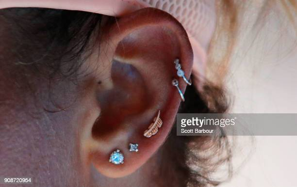 A detail of the ear piercings of Madison Keys of the United States are seen in her fourth round match against Caroline Garcia of France on day eight...